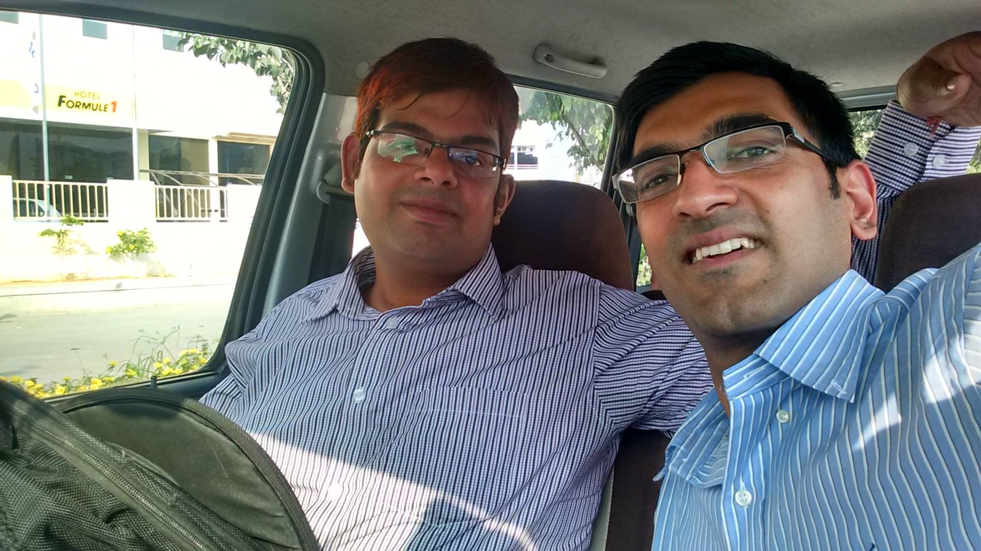 "sRide Team member, Nitin Chadha, travelling from GREEN COUNCIL meeting to HITEC City Hyderabad, India with GREEN CHAMPION of IT industry- ""Uday Shankar"""